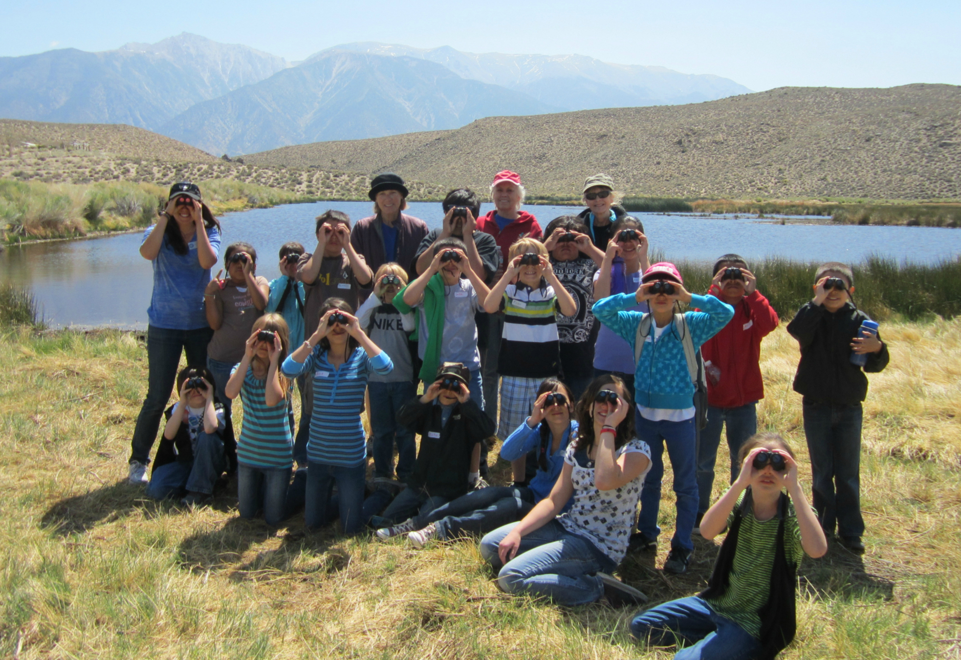 Schoolkids with binoculars at Benton Hot Springs Ranch Conservation Easement